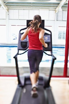Wrist weights help tone your arms while running on a treadmill.
