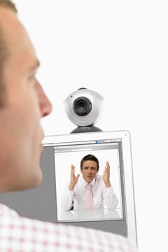 A webcam enables you to teleconference for free over the Internet.