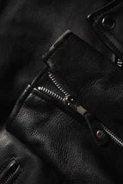 Remove sticker residue with care to keep the leather intact.