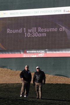 Spectators wait out a frost delay during the 2011 Waste Management Phoenix Open.