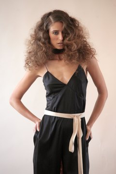 "Big hair and a jumpsuit, like this look here by designer Rita Vinieris, would fit right at at a ""Miama Vice""-themed party."