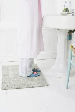 Wash rubber-backed rugs infrequently to protect its backing.