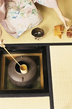 During the ceremony, water is poured slowly from a small bamboo ladle.