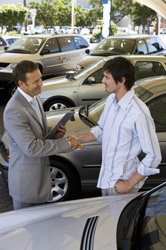 Car dealers help make sure your insurance is in order before you drive away in your new car.