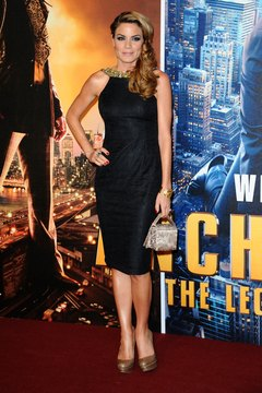 "Charlotte Jackson wears brushed gold pumps with a black dress at the UK premiere of ""Anchorman 2"" in 2013."