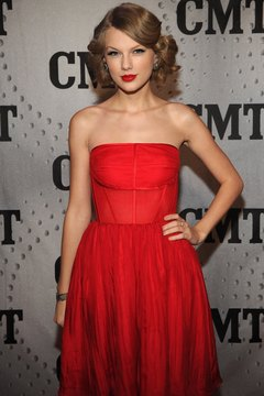 Taylor Swift shows off her shoulders with a strapless dress and glam updo.