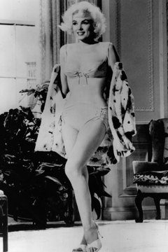 Marilyn Monroe, known for her classic hourglass figure, shows it off in a bra-inspired suit.