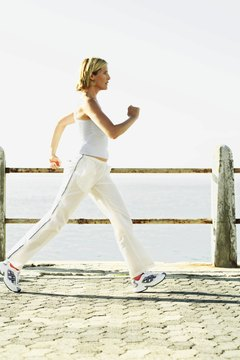 Pump your arms and walk briskly to burn more calories.