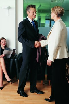 Headhunters interview candidates for their clients