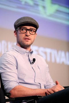 Justin Timberlake's newsboy cap, thick-framed glasses and fitted button-up sum up the geek chic style.