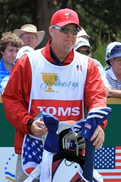 Professional caddies like Scott Gneiser, who carried David Toms' bag in the 2011 President's Cup, play a key role in their pro's success.
