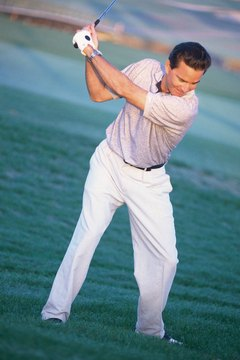 Keeping your head still as you swing will help you maintain the spinal angle.