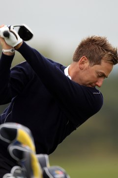 Ian Poulter's club is parallel to the target line at the top of his backswing..