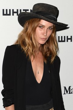 Model Erin Wasson's unkempt curls are a key element to her boho-chic style.