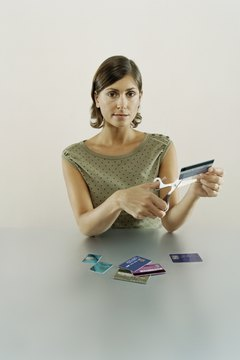 If your credit limit's lowered, don't cut up your card.