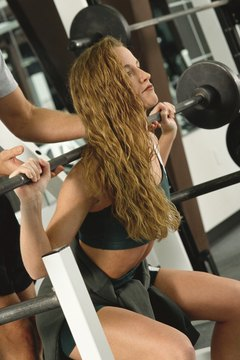 Barbell squats work a myriad of muscles simultaneously.