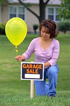 A garage sale clears clutter and gives you money to set aside for savings.