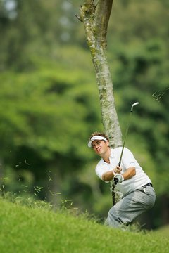 Nick Dougherty makes a flat swing to keep the ball below a tree branch.