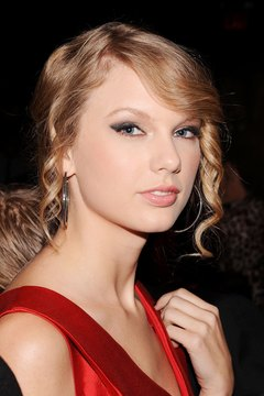 Soften your features with a spiral bang, as Taylor Swift does.