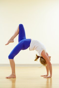 Wheel pose, a full backbend, is a heart-opening asana.
