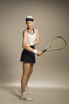 The power of hitting the tennis ball during the swing can cause pain in your elbow tendons.