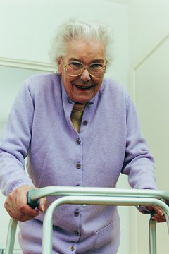 Physical therapists help patients learn to use assistive devices.