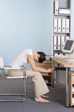 Do exercises at your desk to strengthen your back.