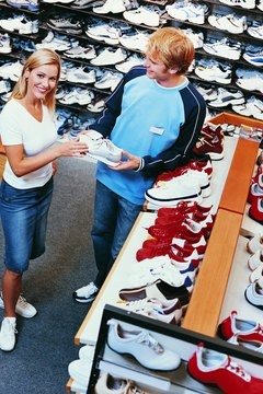 Visit a sporting goods store to try on aerobic shoes.