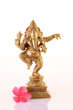 A dancing four-armed Ganesh is a popular and powerful Hindu god.
