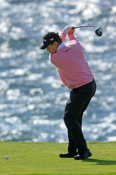 Tom Watson begins his downswing by moving his hips and left heel.