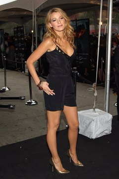 Actress Blake Lively rocks a silky black romper with pointed-toe pumps for a chic evening look.