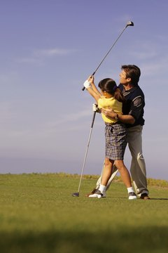A professional instructor can teach you how to bring the club back by turning your shoulders.