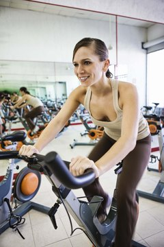 Varying the intensity on a stationary bike may help target the glutes.