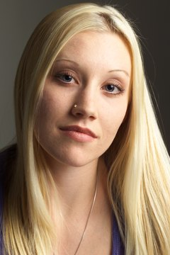 Nose piercing is popular among teenagers.