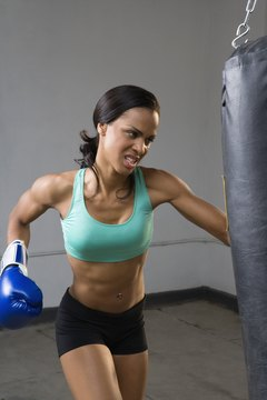 Alternate isometric punch holds with punching bag work to increase your speed and strength.