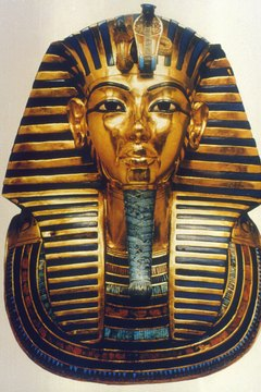 King Tut's 24-pound solid gold burial mask has become a symbol for Egyptology.
