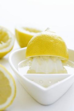 When lemon juice mixes with baking soda, a chemical reaction occurs.