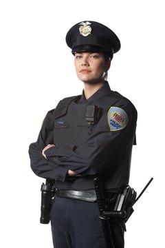 Police officers identify themselves through their uniforms and badges.