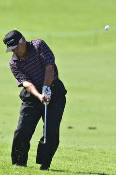 You can clearly see Lee Trevino's firm lead wrist as he chips from the rough.