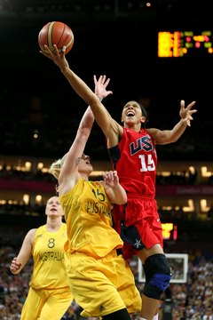 Candace Parker, in Team USA's red uniform, drives against Australia.