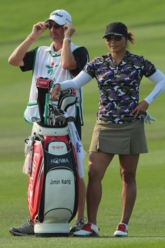 LPGA Tour player Jimin Kang and her caddie consider distance, wind and hazards when selecting a club.