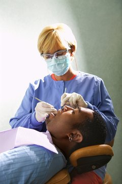 Dental assistants complete administrative and medical care tasks within a dentist's office.