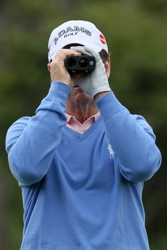 Tom Watson uses a range finder during a practice round prior to the 2010 U.S. Open.