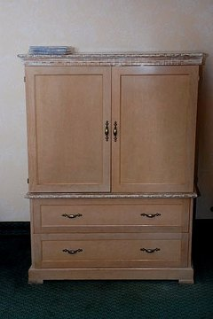An old TV armoire, a sewing station