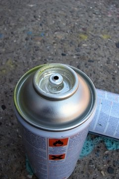 Two cans of spray enamel paint.