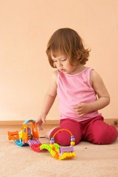 Use different and exciting objects during floor play.