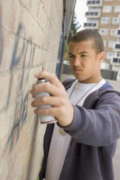 Teen spray painting