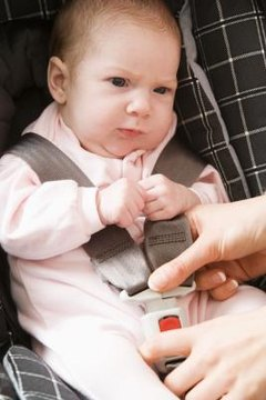 how to put a newborn car seat in