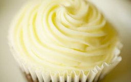 A 2-tablespoon serving of butter-based frosting contains 2.7 grams of saturated fat.
