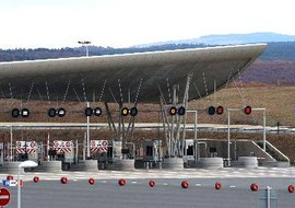 You can include the cost of tolls with your standard mileage expenses.